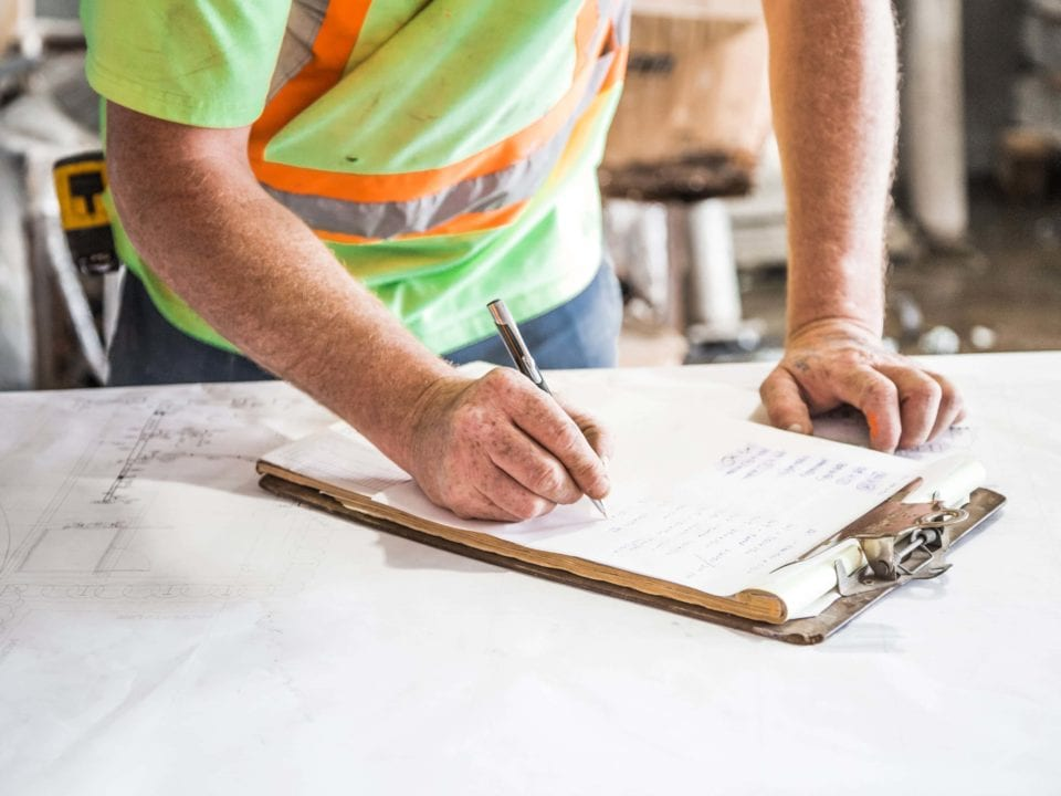 Contractor writing a quote for a client